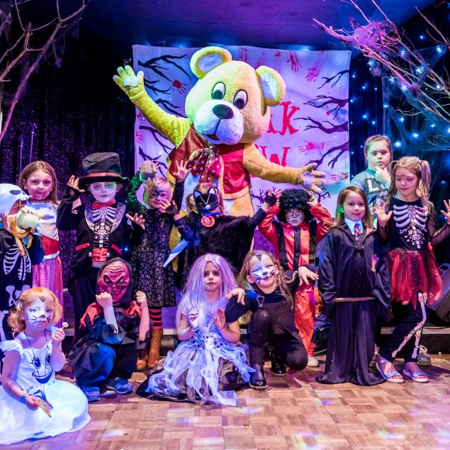 Woolly Bear and children in fancy dress at Woolacombe Sands Holiday Park