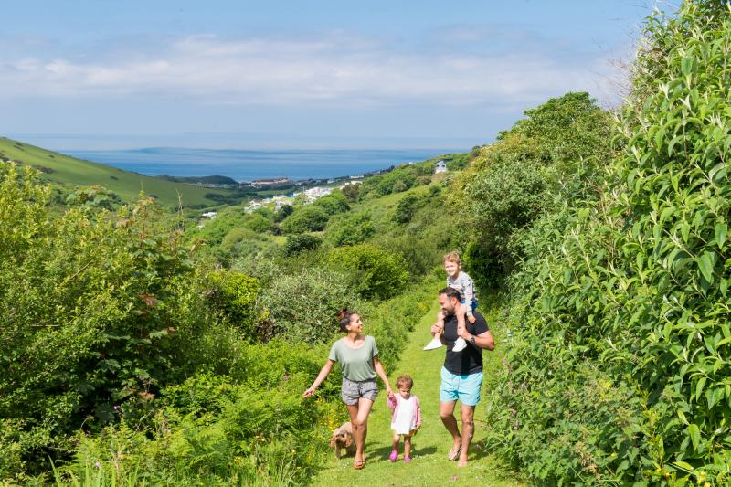 Family Walk to beach at Woolacombe Sands Holiday Parks Devon