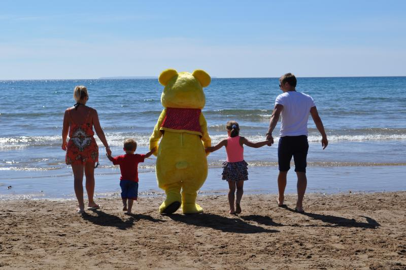 Woolly Bear with a family on Woolacombe Beach
