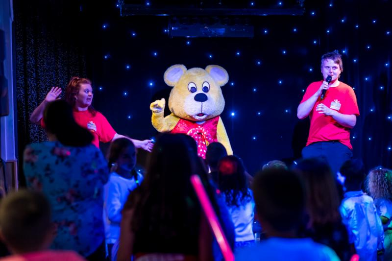 Woolly Bear having fun on the stage at Woolacombe Sands Holiday Park