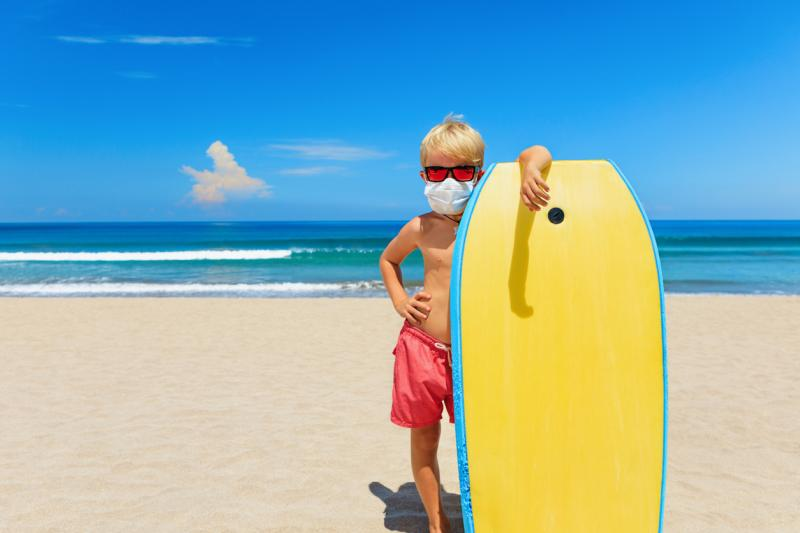 Boy wearing Face Mask on Family Beach Holiday in Devon